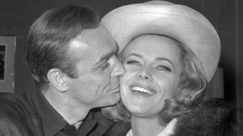 Sean Connery kisses Honor Blackman during a party at Pinewood Film Studios, in Iver Heath, England, on March 25, 1964. (AP)