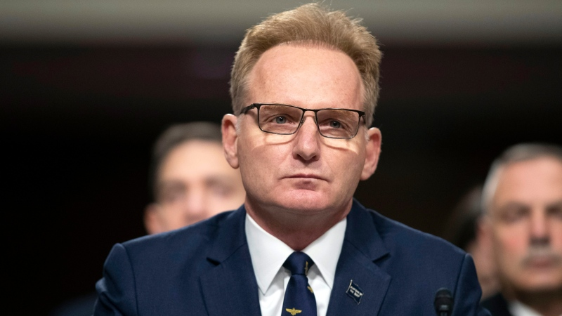 """In this Dec. 3, 2019, file photo, acting Navy Secretary Thomas Modly testifies during a hearing of the Senate Armed Services Committee about about ongoing reports of substandard housing conditions in Washington, on Capitol Hill. Modly says the captain of the COVID-stricken aircraft carrier who was fired last week had betrayed his service and may have been """"too naive or too stupid"""" to be commanding officer of the ship. Officials are confirming that Modly made the comments Sunday, April 5, 2020, to the ship's crew in Guam. (AP Photo/Alex Brandon, File)"""