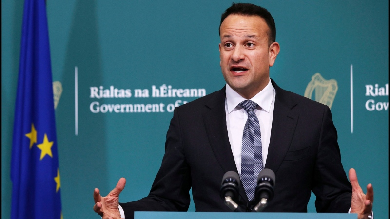 Leo Varadkar addressing media at a Covid-19 press briefing at Government Buildings in Dublin, Ireland, as he announces sweeping measures to limit the spread of coronavirus, including restricting all public gatherings to four people or less, Tuesday March 24, 2020. (Steve Humphreys / PA via AP)