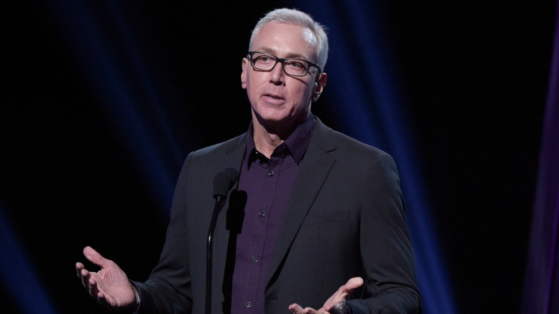 "This Jan. 18, 2019 file photo shows Drew Pinsky speaking at the 2019 iHeartRadio Podcast Awards in Burbank, Calif. Pinsky has apologized for a series of statements unspooled in a recent video where he downplayed the coronavirus and suggested that it was a ""press-induced panic."" (Photo by Richard Shotwell/Invision/AP, File)"