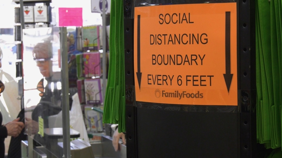 A sign at Family Foods tells customers to practice social distancing and stay six feet away from each other (CTV News Photo Josh Crabb)