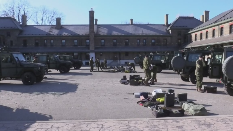 Military personnel gear up for critical mission
