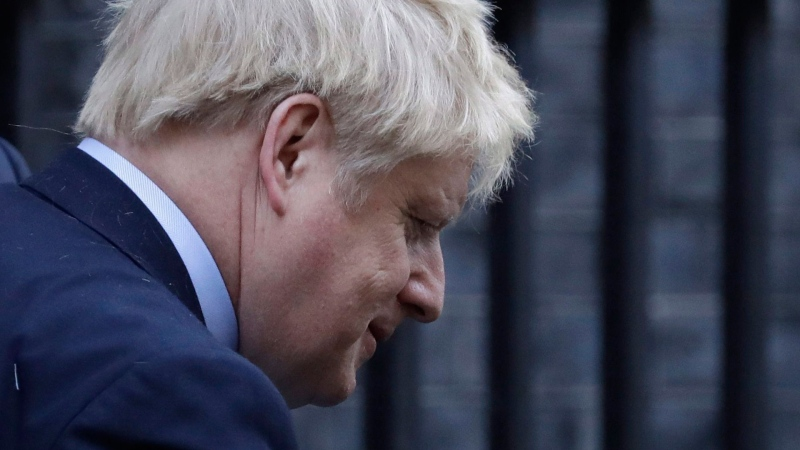 Britain's Prime Minister Boris Johnson gets into his official car as he leaves 10 Downing Street for the House of Commons for his weekly Prime Ministers Questions, in London, Wednesday, March 25, 2020.(AP / Matt Dunham)