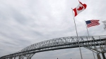 Vehicles move across the Blue Water Bridge in Port Huron, Mich., to Sarnia, Ontario, Canada, Wednesday, March 18, 2020. (AP / Paul Sancya)
