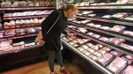 Erin Call wears a mask as she shops for groceries at Harmons grocery store Friday, April 3, 2020, in Salt Lake City. (AP / Rick Bowmer)