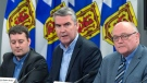 Premier Stephen McNeil, is flanked by Health Minister Randy Delorey, left, and Dr. Robert Strang, chief medical officer of health, as tthey announce three presumptive cases of COVID-19 in Nova Scotia, at a news conference in Halifax on Sunday, March 15, 2020. THE CANADIAN PRESS/Andrew Vaughan