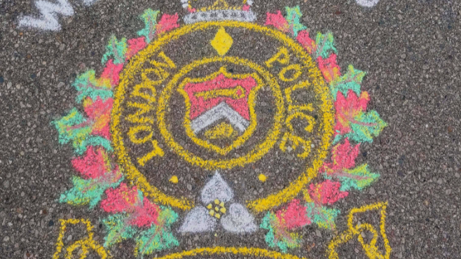 Police Logo in Chalk by Bronagh Morgan.