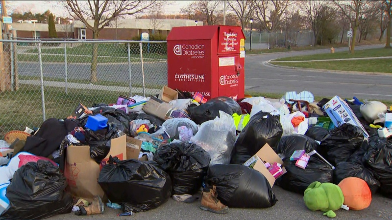 Items and garbage is shown piled up beside a Diabetes Canada donation bin near Renforth Road and Rathburn Drive on Tuesday morning.