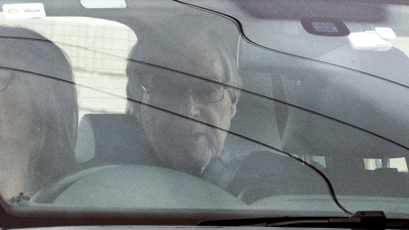 Cardinal George Pell sits in the back seat of a car as he leaves prison in Geelong, Australia, on April 7, 2020. (James Ross / AAP Image via AP)