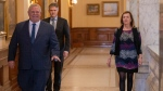 Ontario Premier Doug Ford arrives with Health Minister Christine Elliott and Finance Minister Rod Phillips for the daily briefing at Queen's Park in Toronto on Saturday April 4, 2020. THE CANADIAN PRESS/Frank Gunn