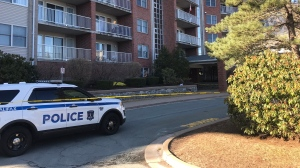 Halifax Regional Police respond to an apartment building on Carrington Place on April 7, 2020.
