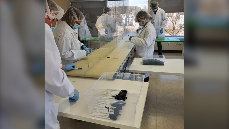 Workers at L-D Tool and Die in Stittsville make testing swabs. (Photo courtesy of Laurie Dickson)