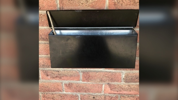 London, Ont. resident Melanie Edwards, whose husband Shawn Edwards is a letter carrier with Canada Post, took to Facebook on to share a photo of her mail box propped open by a stick. (Courtesy of Melanie Edwards)