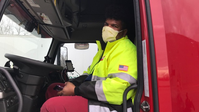 Long-haul transport driver Jordan Jeffreys of Illinois, says he's chosen to wear a mask while delivering groceries into Canada, while stopped in Elgin County, Ont. on Tuesday, April 7, 2020. (Sean Irvine / CTV London)