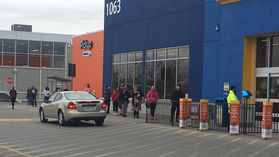 Shoppers lineup outside the Walmart location in St. Thomas, Ont. on Tuesday, April 7, 2020. (Brent Lale / CTV London)