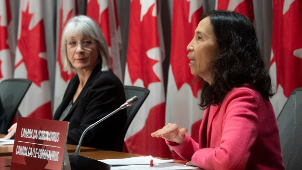 Minister of Health Patty Hajdu looks on as Chief Public Health Officer Theresa Tam responds to a question during a news conference in Ottawa, Thursday, April 2, 2020. THE CANADIAN PRESS/Adrian Wyld