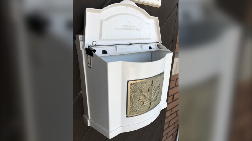 A mail box is propped open using binder clips in Quebec. (Courtesy of Robert Chagnon)