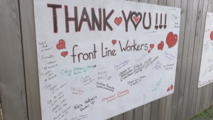 The wall enables passersby to add the names of people they consider to be personal heroes during the COVID-19 pandemic. (CTV News)