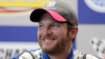 In this Oct. 6, 2017, file photo, Dale Earnhardt Jr. smiles during a NASCAR news conference at Charlotte Motor Speedway in Concord, N.C. (AP Photo/Chuck Burton, File)
