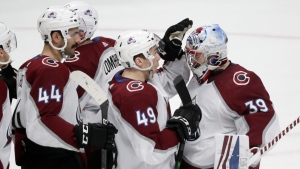 Colorado Avalanche defenseman Samuel Girard (49) celebrates with goaltender Pavel Francouz (39), of the Czech Republic, after a 3-2 win over the Nashville Predators in an NHL hockey game Saturday, Feb. 29, 2020, in Nashville, Tenn. (AP Photo/Mark Humphrey)