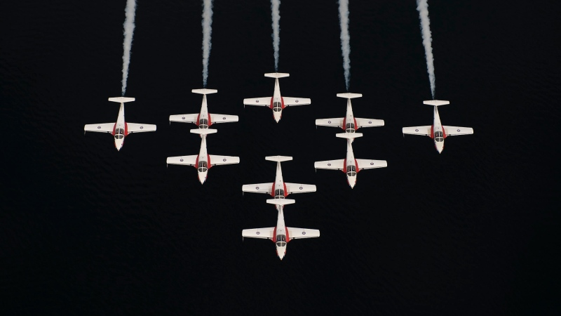 The Canadian Forces Snowbirds fly in Silver Dart formation over the Strait of Georgia while training at 19 Wing Comox. (Department of National Defence/Sgt Robert Bottrill)