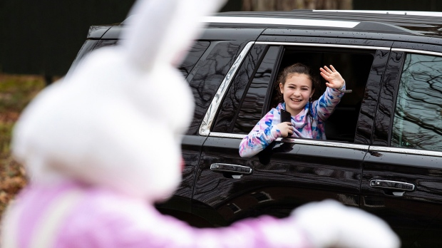 Easter Bunny waves to little girl in car