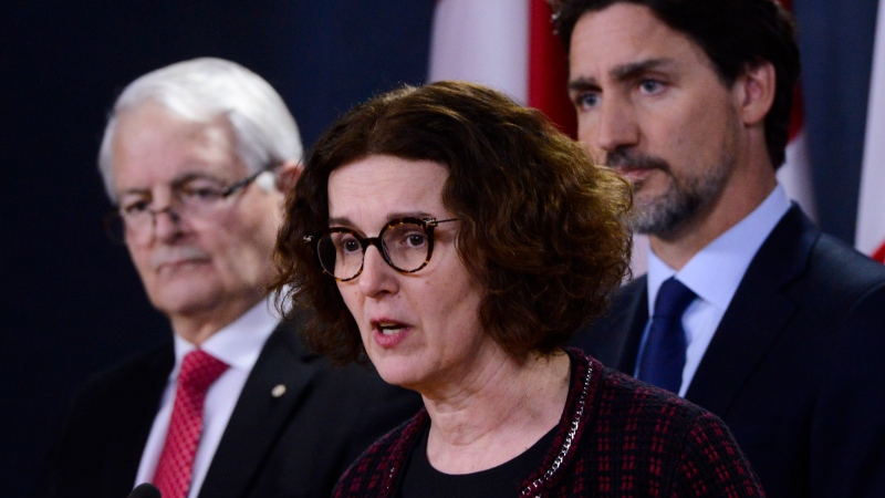 Deputy Minister of Foreign Affairs Marta Morgan speaks as Minister of Transport Marc Garneau, left, and Prime Minister Justin Trudeau, right, look on as they hold a press conference at the National Press Theatre in Ottawa on Wednesday, Jan. 8, 2020. THE CANADIAN PRESS/Sean Kilpatrick