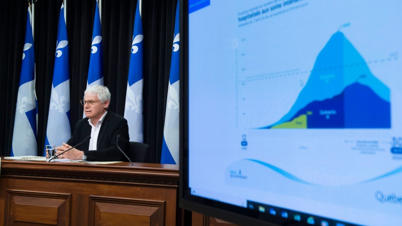 Richard Masse, public health strategic advisor responds to reporters on projections during a news conference on the COVID-19 pandemic, Tuesday, April 7, 2020 at the legislature in Quebec City. THE CANADIAN PRESS/Jacques Boissinot