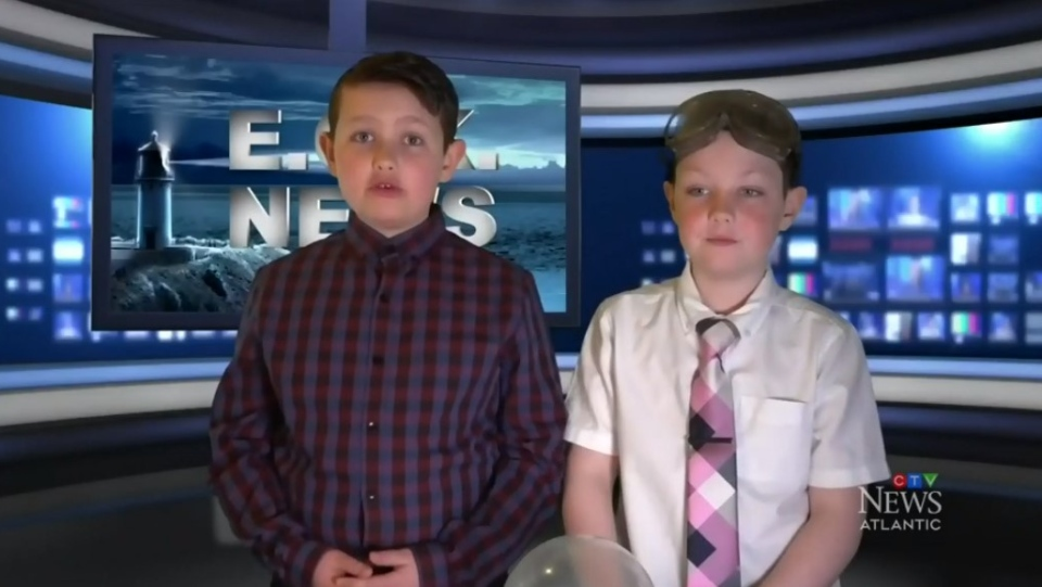 Liam Sakalauskas (left) and his brother Lucas have been broadcasting E.C.K. News out of their basement  during the COVID-19 pandemic.