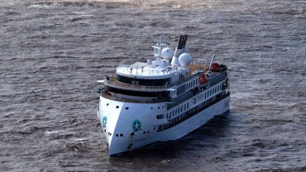 The Greg Mortimer, a cruise liner operated by Australia's Aurora Expeditions, departed March 15 on a voyage to Antarctica and South Georgia. (Pablo Porciuncula/AFP via Getty Image)