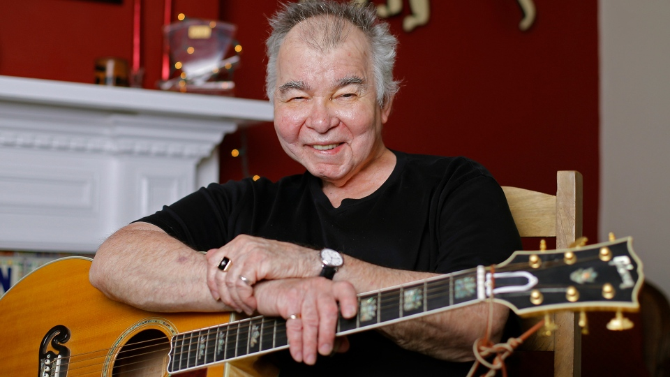 John Prine poses in his office