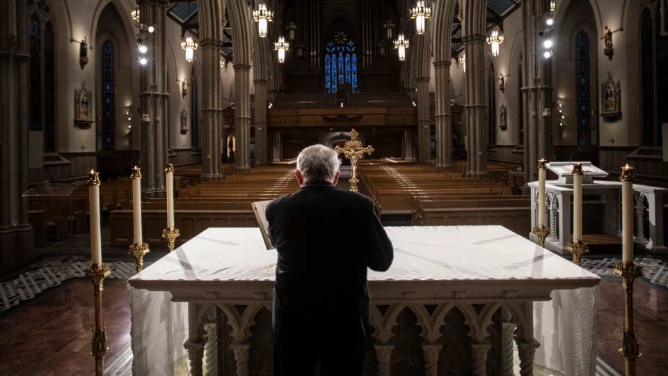 Cardinal Thomas Collins, the Catholic Archbishop of Toronto, prepares to perform a live-streamed mass at St. Michael's Cathedral in Toronto, on Wednesday, March 25, 2020, after churches were closed due to the COVID-19 pandemic. THE CANADIAN PRESS/Chris Young