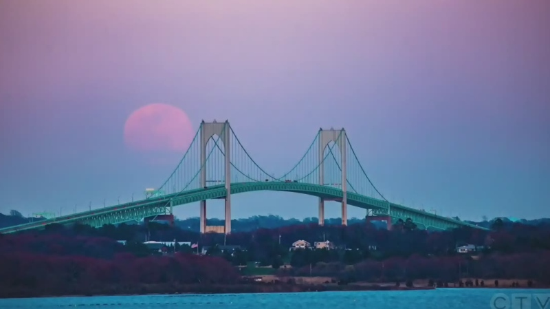 'Pink' supermoon rises Over U.S. bridge