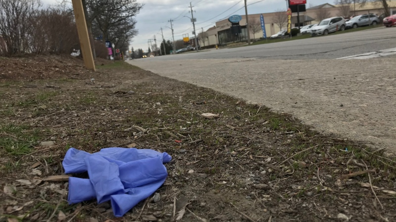 A discarded PPE glove beside a Waterloo Region road. (Dan Lauckner/CTV Kitchener) (Apr. 7, 2020)