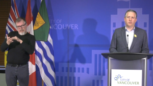Vancouver Mayor Kennedy Stewart, right, makes a public appeal for financial support from the B.C. government during the COVID-19 crisis on April 8, 2020.
