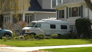 A recreational vehicle (RV) is seen parked in an Oak Bay driveway: April 8, 2020 (CTV News)
