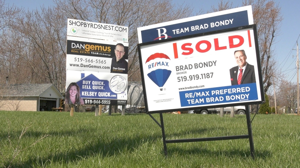 Real estate signs in Amherstburg, Ont.