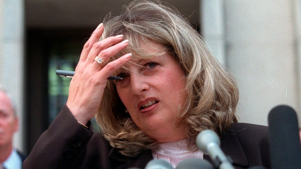In this July 29, 1998 file photo Linda Tripp talks to reporters outside federal court in Washington. (AP Photo/Khue Bui)