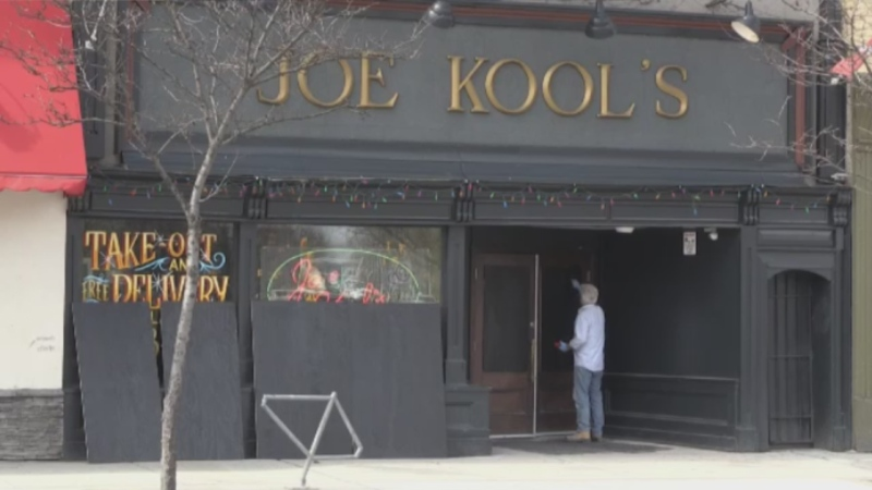 Crews board up Joe Kool's in downtown London, Ont. on Wednesday, April 8, 2020. (Jim Knight / CTV London)