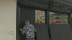 Downtown business boarded up for protection
