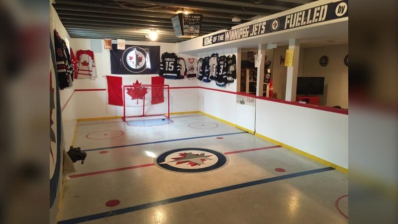 Jeremy Harder's basement mini-stick rink shows his support for the Winnipeg Jets (Courtesy Twitter: @jertam1)