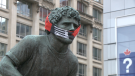 The Terry Fox statue on Wellington Street in Ottawa is seen sporting a face mask. Famous runner statues across North America now have masks on them to help spread awareness about COVID-19 safety.