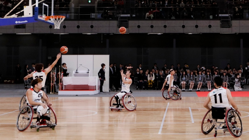 FILE - In this Feb. 2, 2020, file photo, members of Japan's national wheelchair basketball team warm up on the court during a grand opening ceremony of the Ariake Arena, a venue for volleyball at the Tokyo 2020 Olympics and wheelchair basketball during the Paralympic Games, in Tokyo. (AP Photo/Jae C. Hong, File)