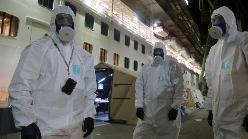 In this Wednesday, April 8, 2020, photo provided by the New South Wales Police, investigators in protective gear prepare to board the Ruby Princess cruise ship at Wollongong, Australia. (Nathan Patterson/NSW Police via AP)