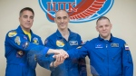 In this handout photo released by Roscosmos U.S. astronaut Chris Cassidy, left, Russian cosmonauts Anatoly Ivanishin, centre, and Ivan Vagner, members of the main crew to the International Space Station (ISS), pose during a news conference at the Baikonur Cosmodrome, Kazakhstan, Wednesday, April 8, 2020. (Roscosmos Space Agency Press Service via AP)