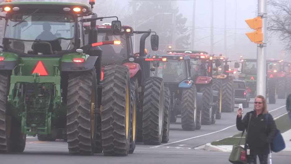 Farmers are seen driving by St. Thomas Elgin General Hospital in Elgin County, Ont., on April 8, 2020 to pay tribute to healthcare staff working the frontlines of the COVID-19 pandemic.