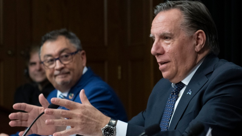 Quebec Premier Francois Legault, right, speaks to reporters during a news conference on the COVID-19 pandemic at the legislature in Quebec City. Horacio Arruda, Quebec director of National Public Health, looks on. THE CANADIAN PRESS/Jacques Boissinot