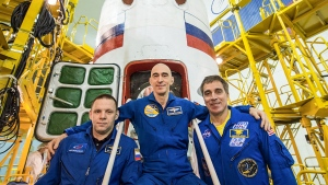 At the Baikonur Cosmodrome in Kazakhstan, Expedition 63 crewmembers Ivan Vagner (left) and Anatoly Ivanishin (center) of Roscosmos and Chris Cassidy (right) of NASA pose for pictures on April 3 in front of their Soyuz spacecraft as part of their pre-launch activities. (Roscosmos/NASA)