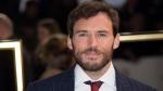 Actor Sam Claflin poses in London, on Nov. 20, 2019. (Joel C Ryan / Invision / AP)
