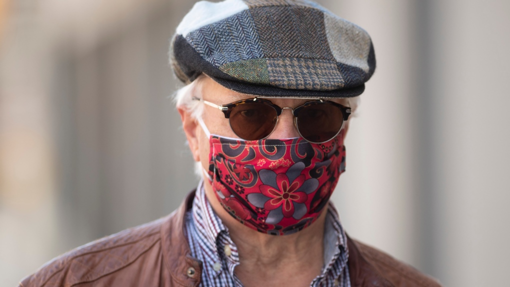 Ottawa man wears a mask quilted by his wife